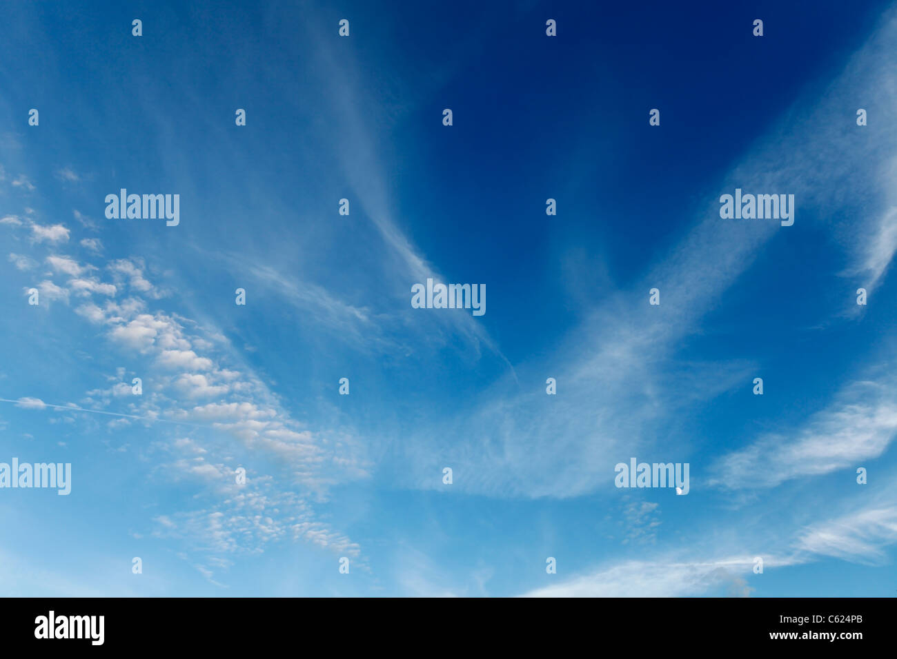 Wispy Cloud on a Summers Day Stock Photo