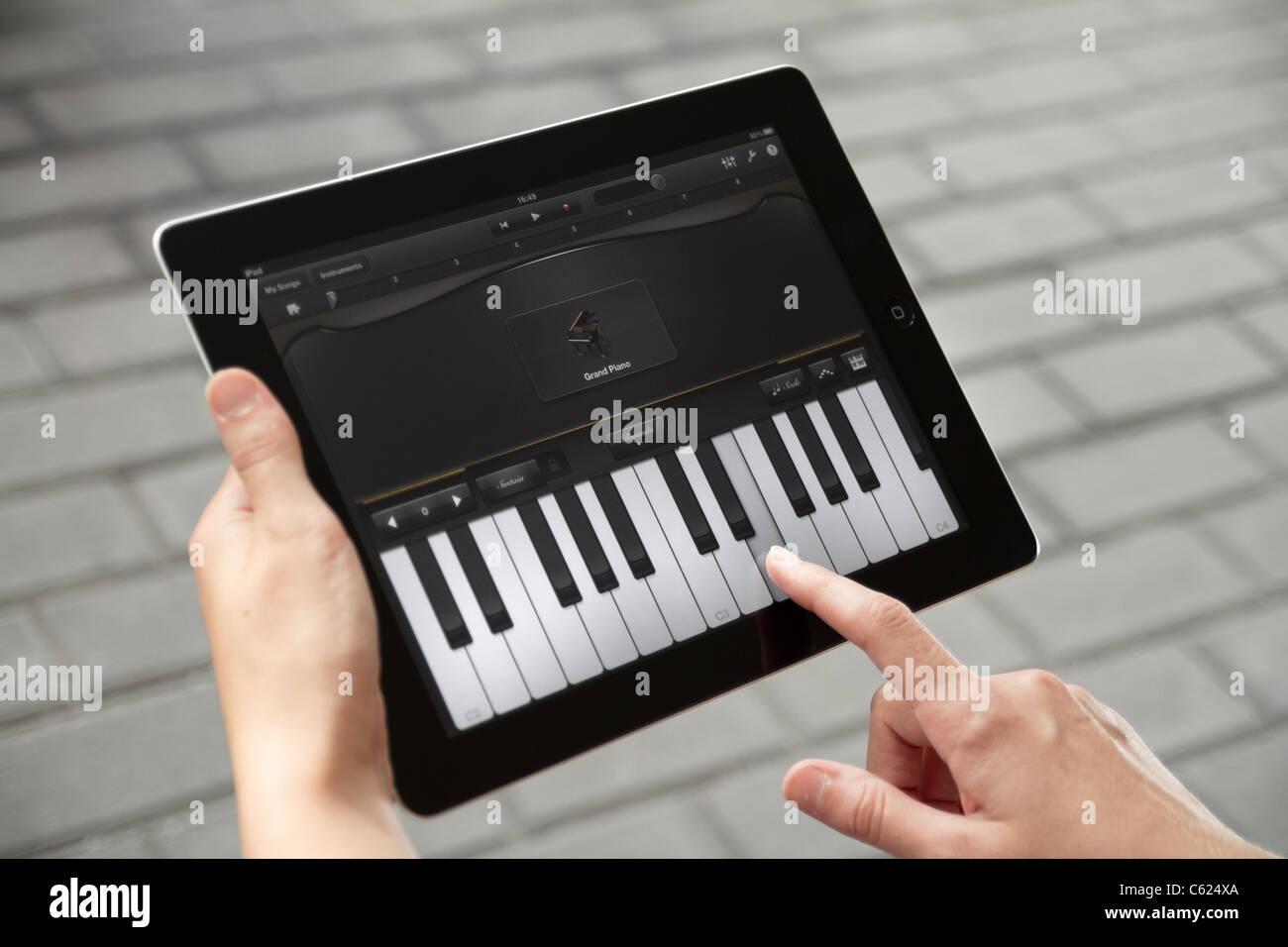 Piano Garage Band : A woman outdoors playing the piano which included in garageband