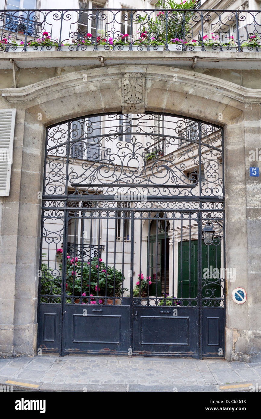 Elaborate gates at the entrance to Petit Hotel de Marigny, Paris, France - Stock Image