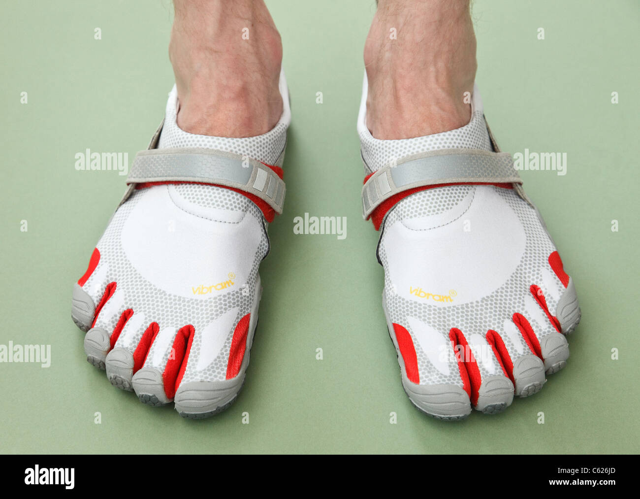 buy online 0bd90 125c2 A man wearing a pair of Vibram FiveFingers Bikila barefoot minimalist  athletic walking and running sports shoes.