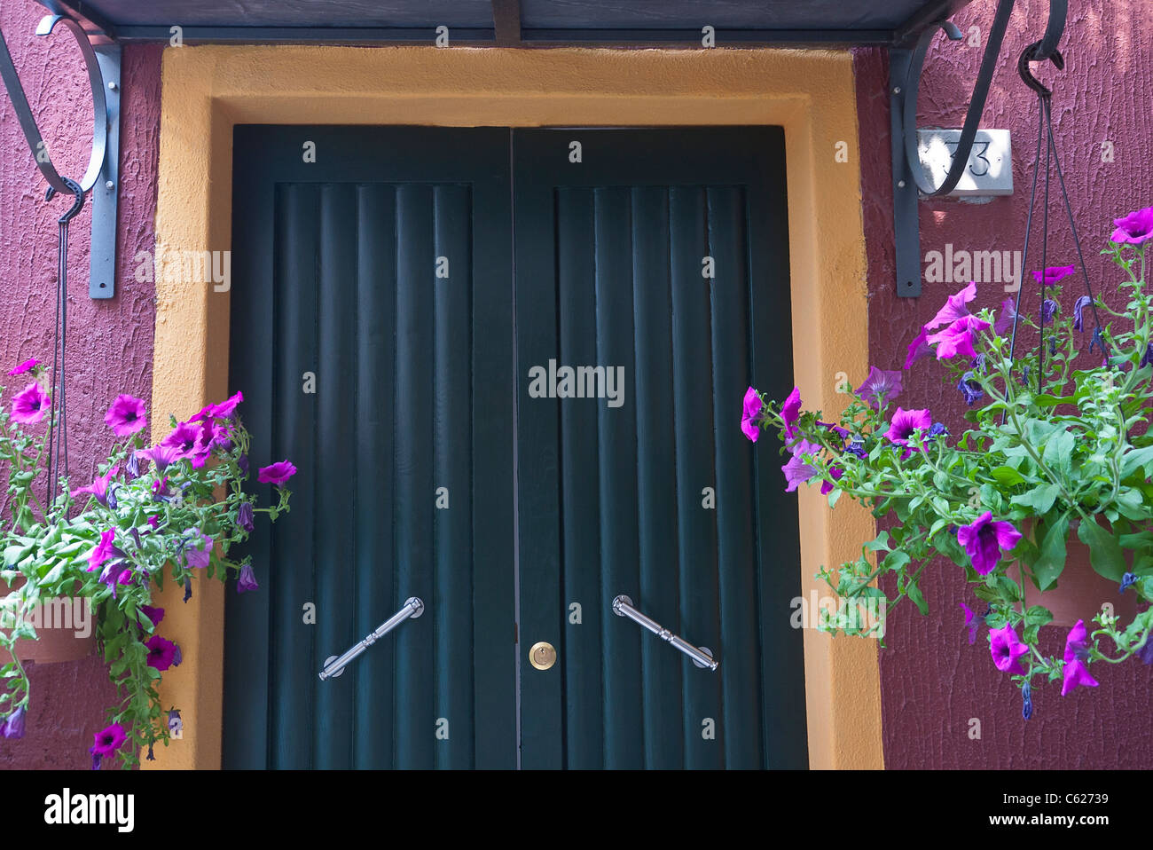 Flower Pots Hanging On Either Side Of Front Door Stock Photos