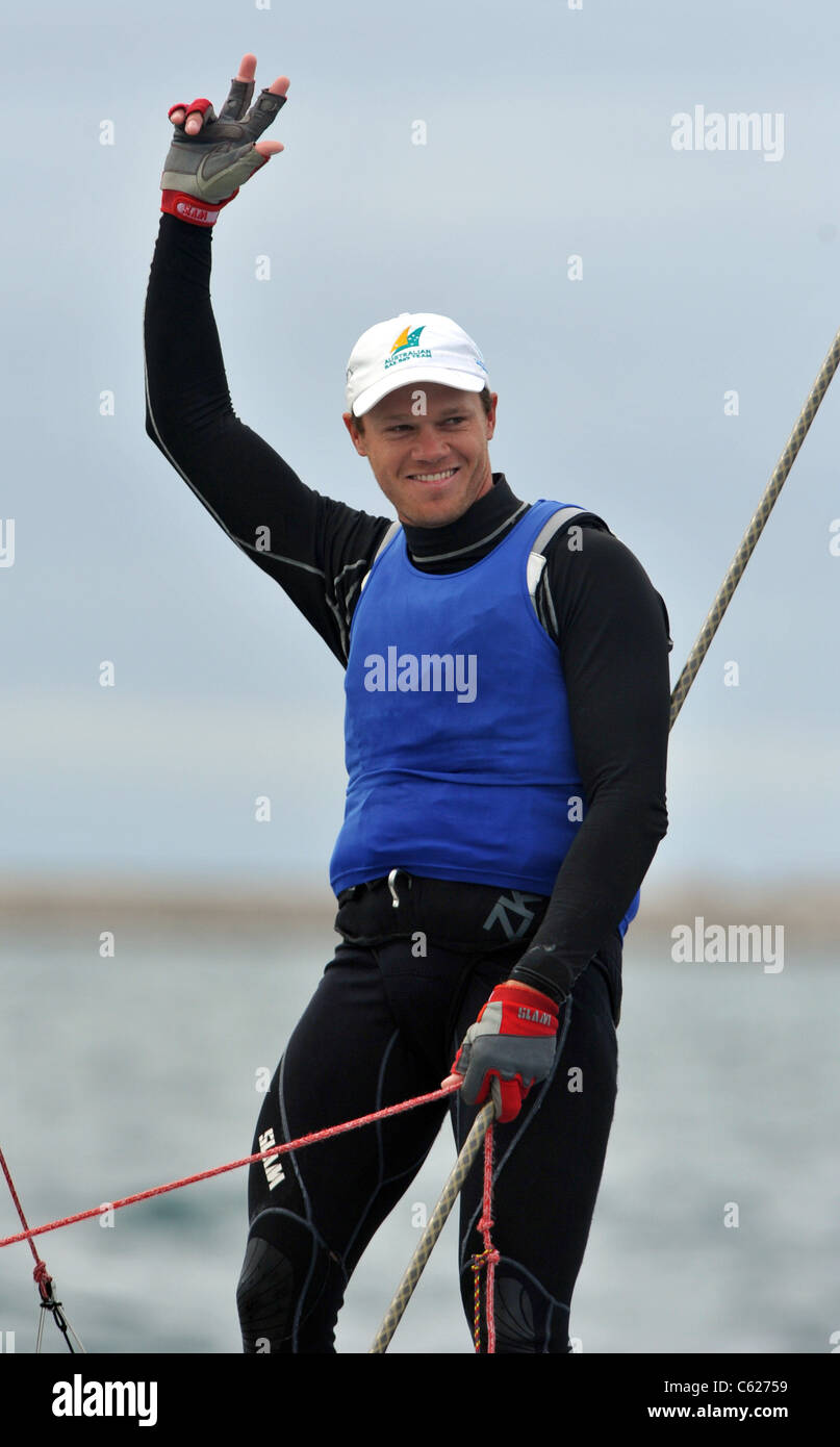 UK, Olympic Test Event, Nathan Outteridge wins Gold in the 49ER Class medal race for Australian - Stock Image