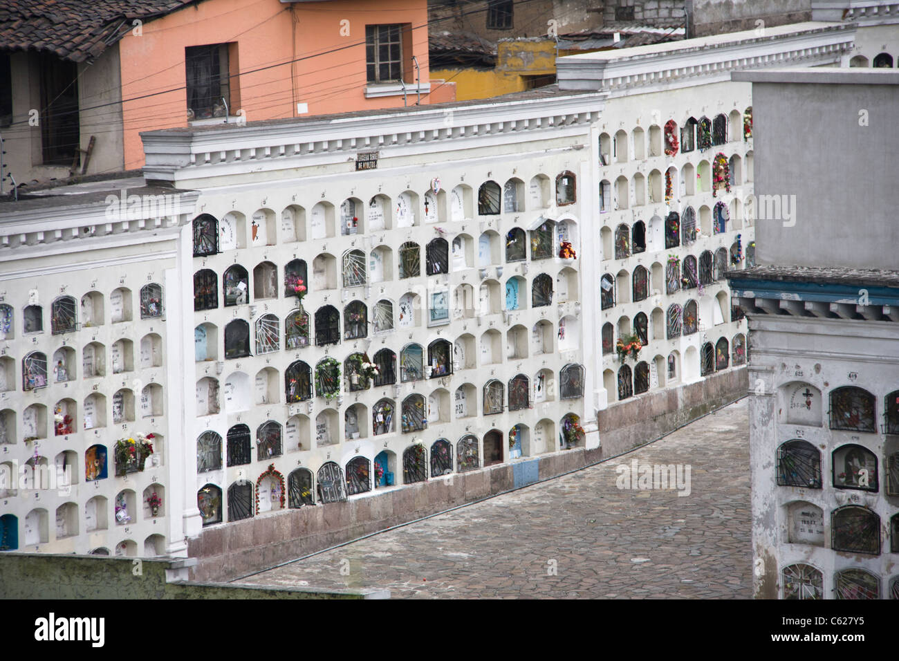 Cemetery vaults in Quito, Ecuador. Space is at a premium, so burial is in stacked vaults. - Stock Image
