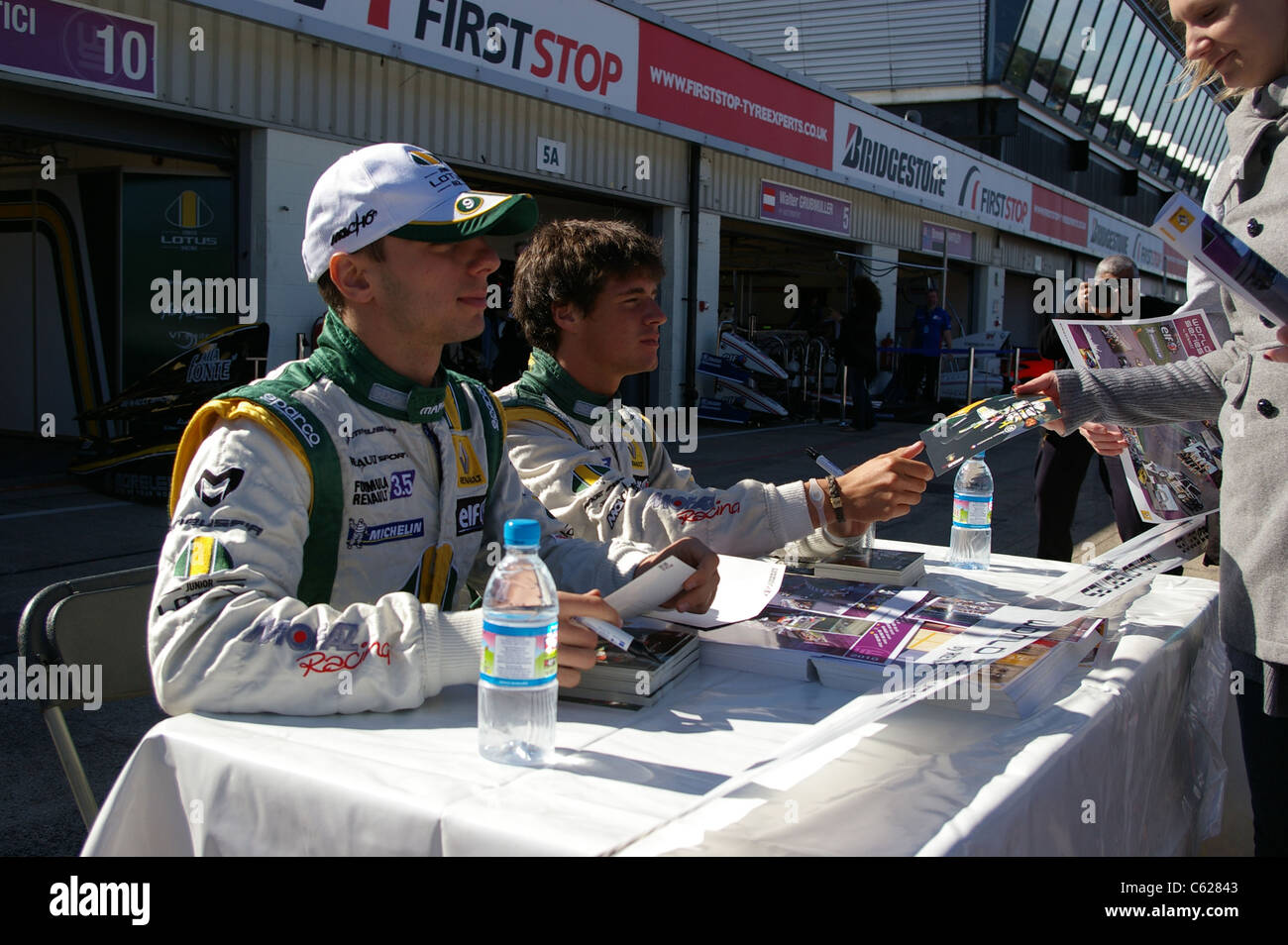 Drivers of Junior Team Lotus, Nelson Panciatici and Daniil Move give autographs before the race on World Series - Stock Image