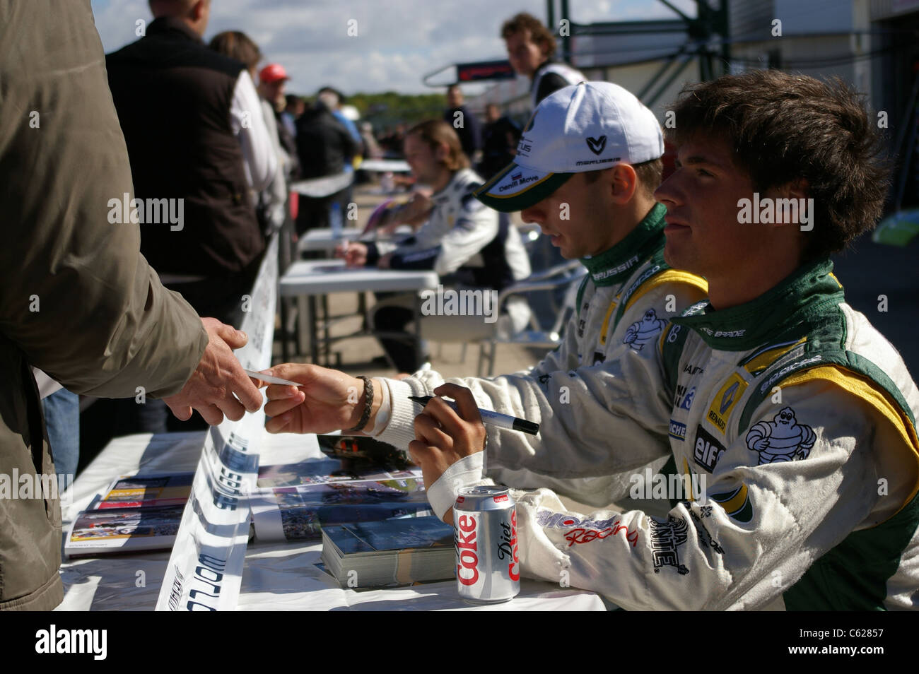 Drivers of Junior Team Lotus, Nelson Panciatici and Daniil Move give autographs. - Stock Image