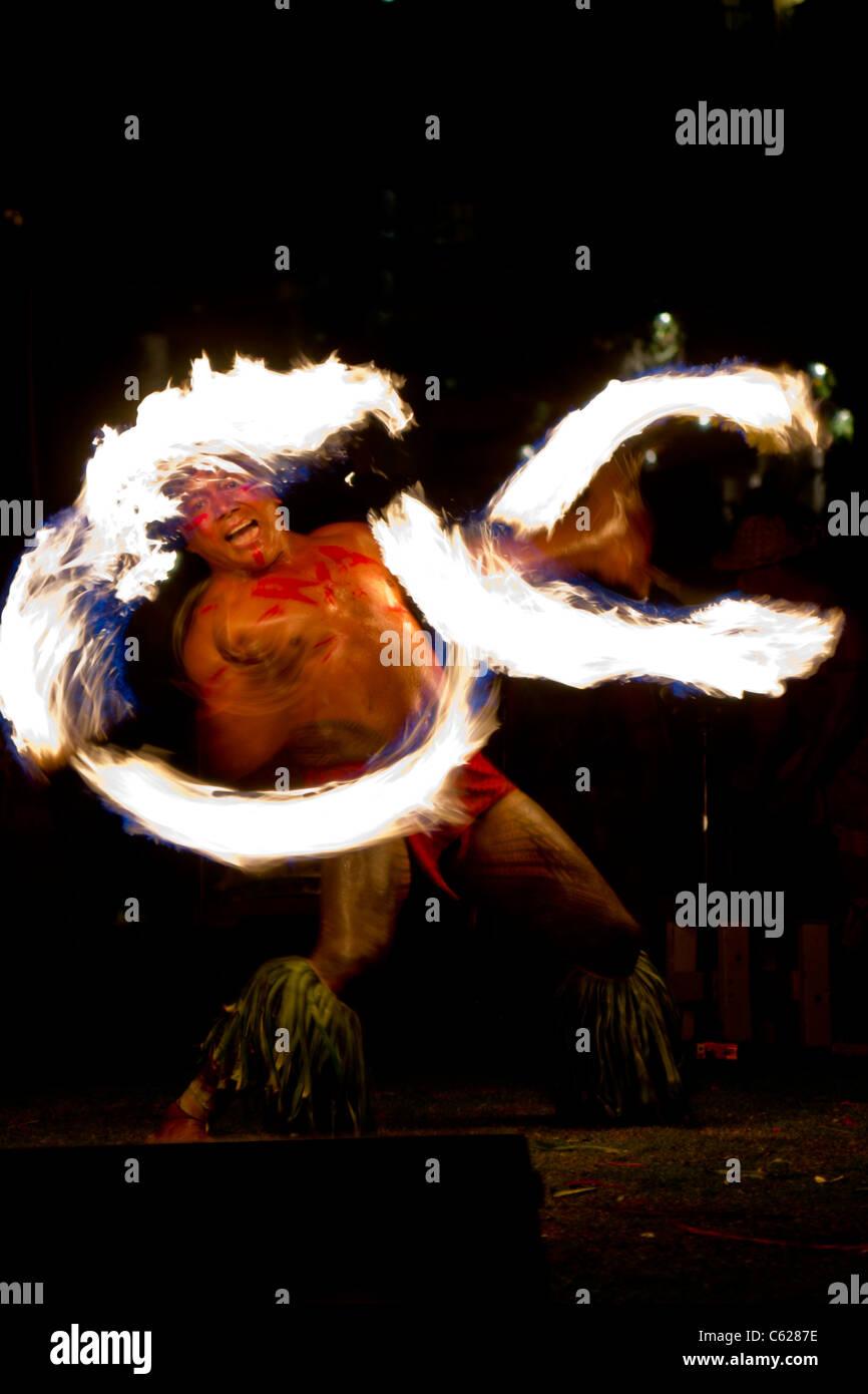 Chief Sielu Avea performs fire knife dance during FiaFia show at Ko' Olina Beach Club Stock Photo