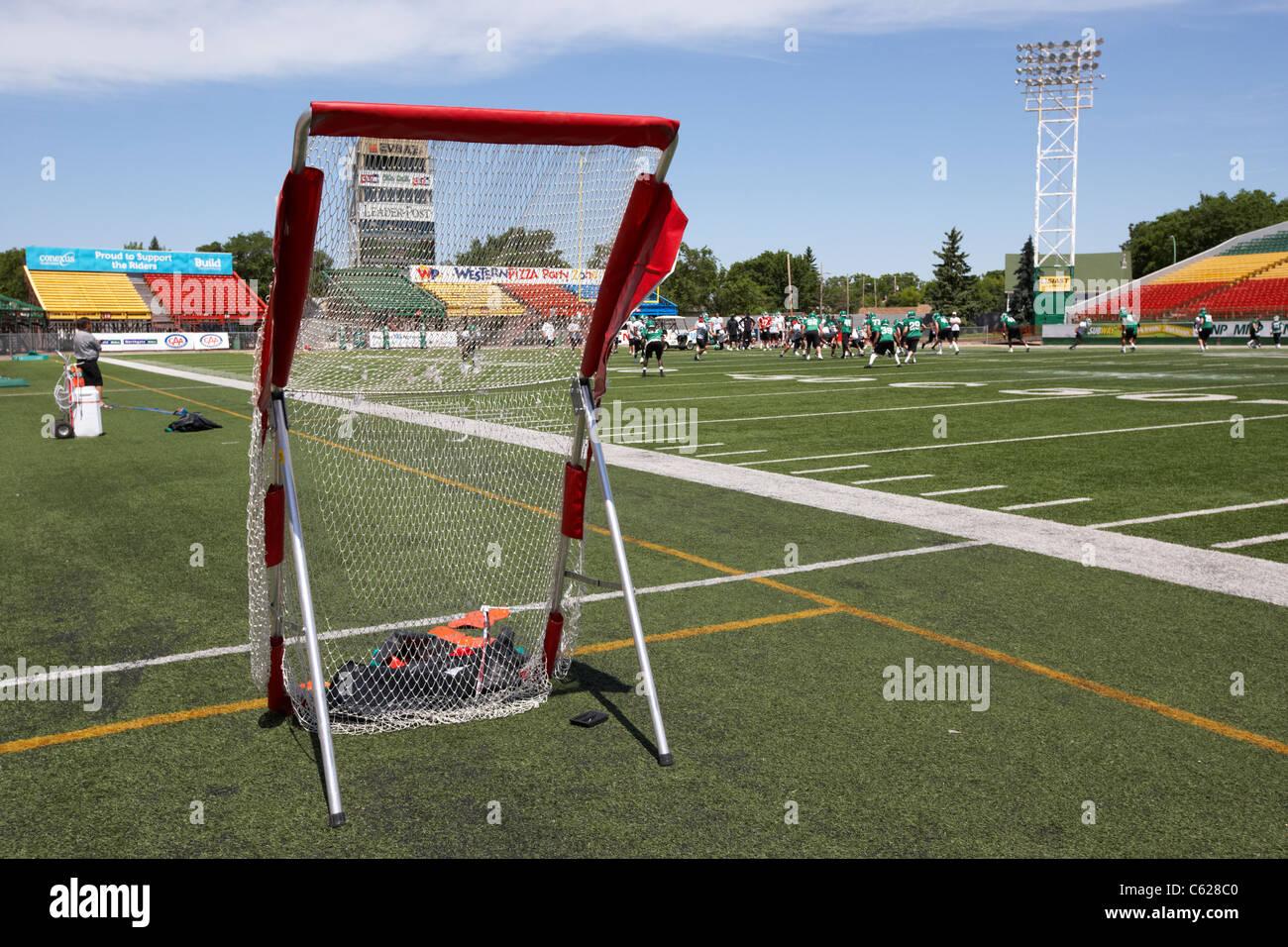 sidelines and practice kicking net saskatchewan roughriders pre season training mosaic stadium taylor field regina - Stock Image