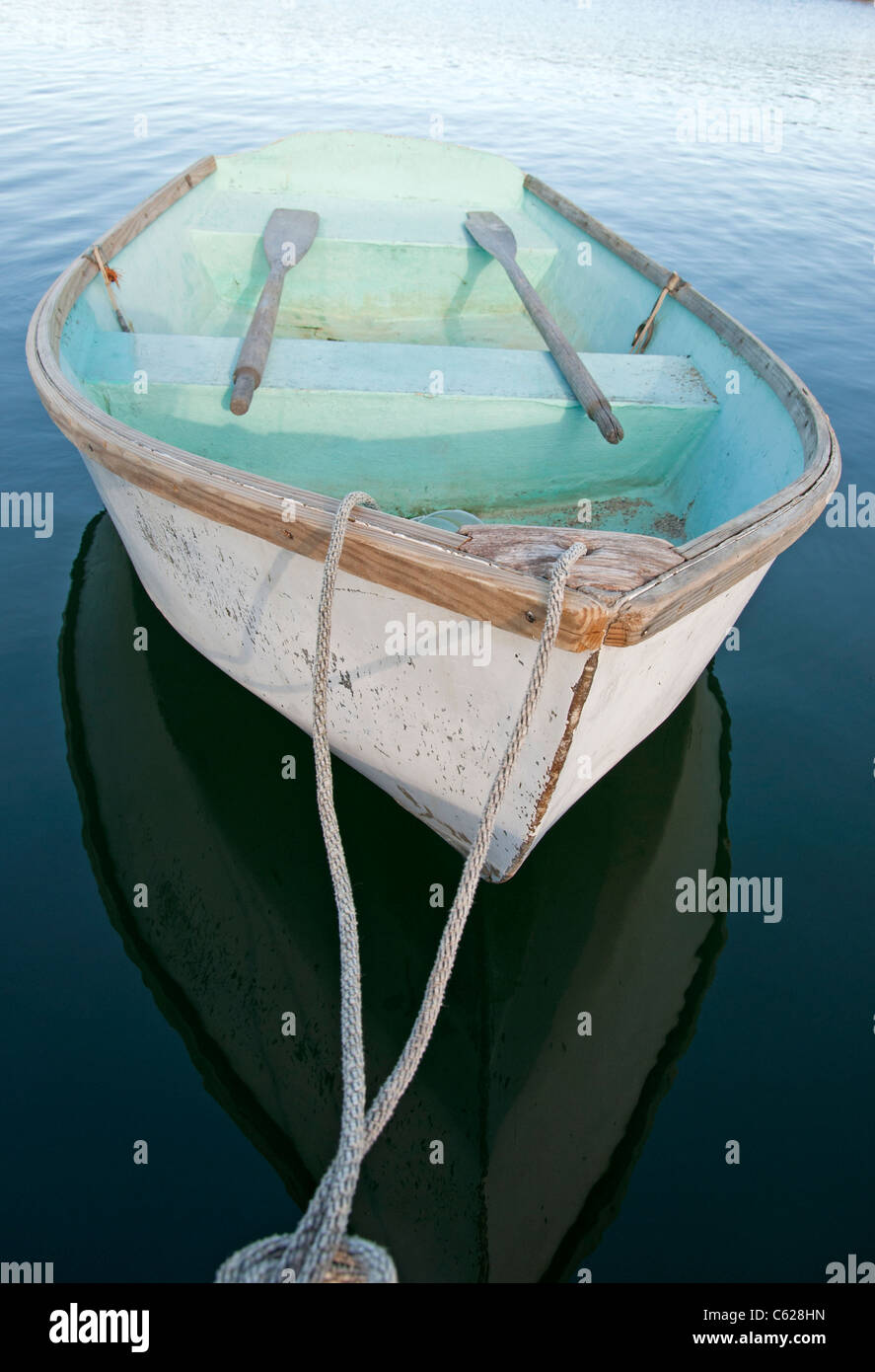 dinghy with oars tied off - Stock Image