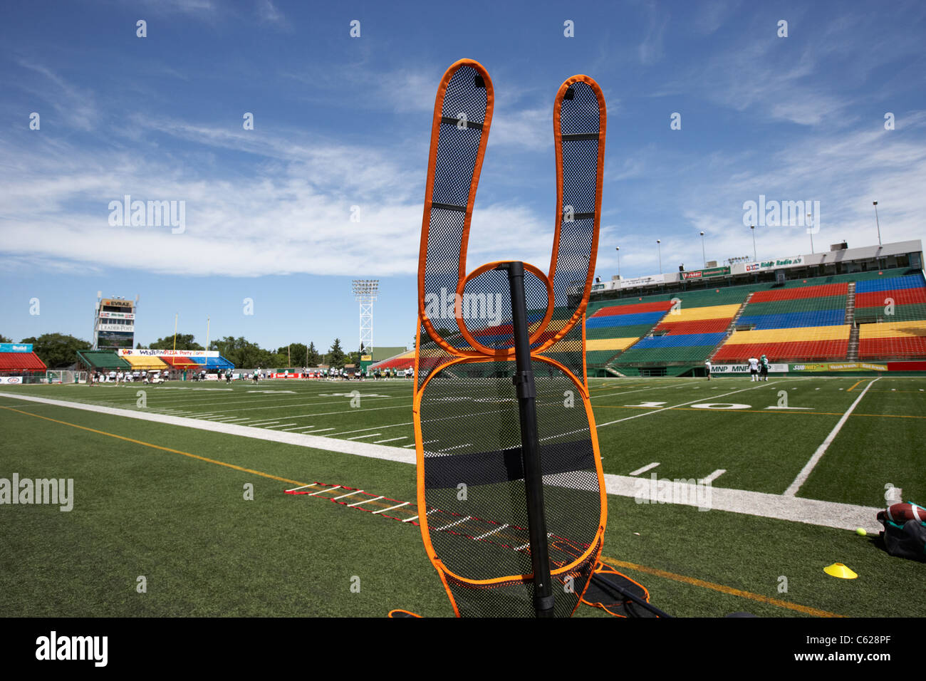 portable defender dummy on the sideline at saskatchewan roughriders pre season training mosaic stadium taylor field - Stock Image