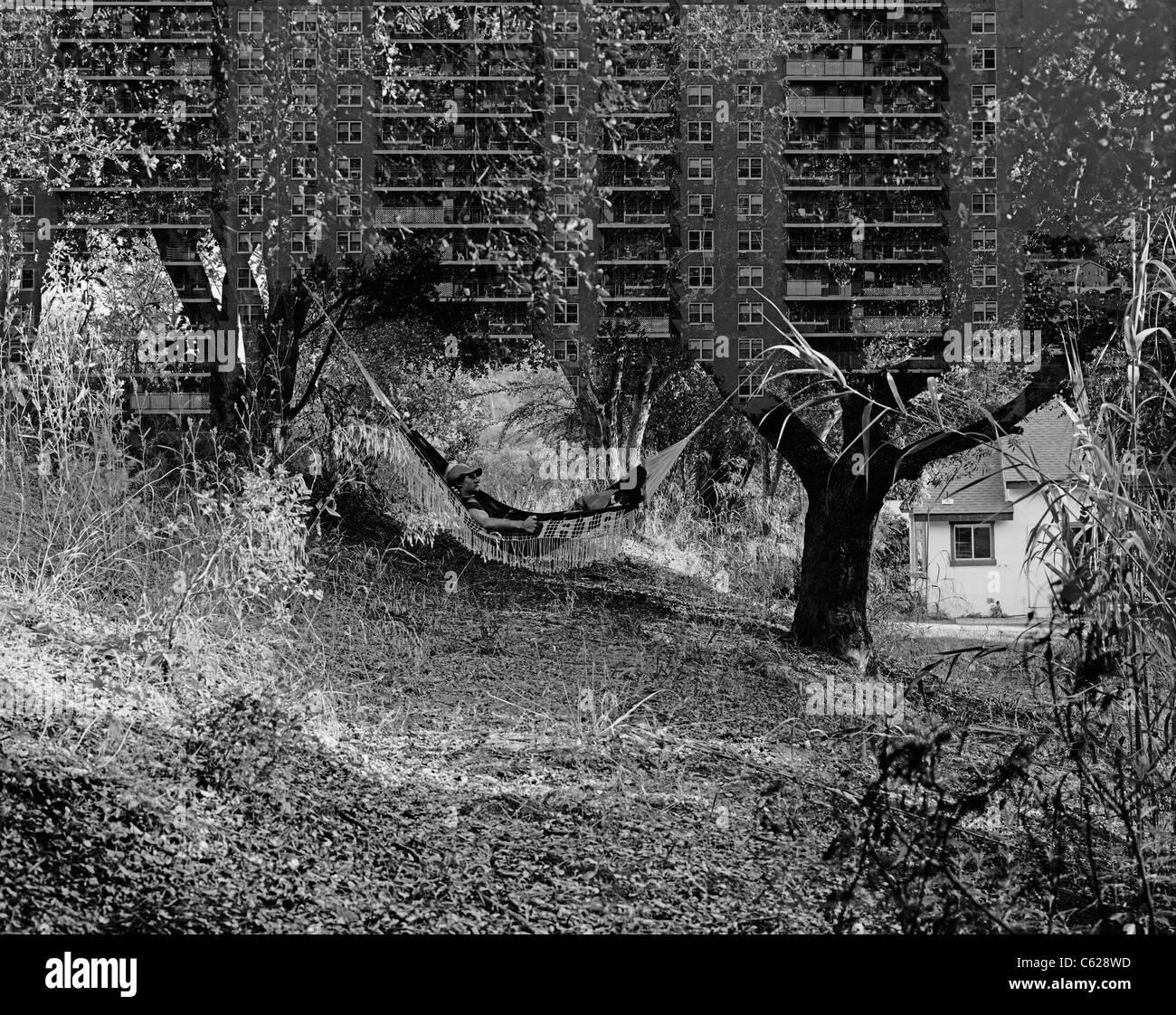 4x5 B&W film double exposure of man in hammock & apartment building in New York. © Craig M. Eisenberg - Stock Image