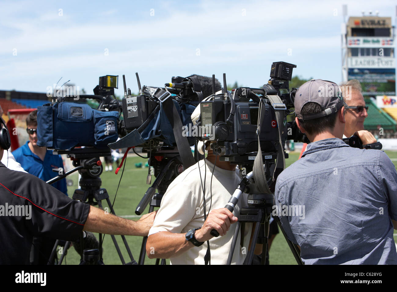 canadian media tv camera crews cameras on tripods with mics regina canada - Stock Image