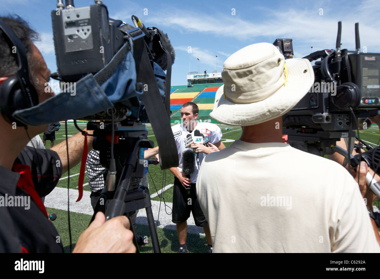 saskatchewan roughriders slotback weston dressler being interviewed during pre season training mosaic stadium taylor - Stock Image
