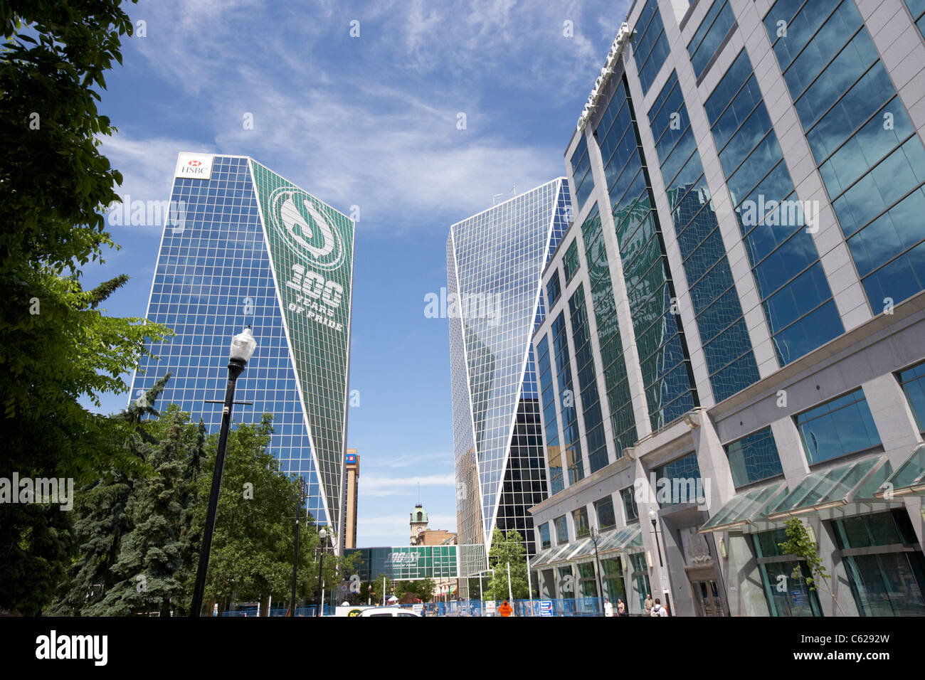 HSBC mcallum hill centre building with 100 year anniversary roughriders logo and canada life building in the financial - Stock Image