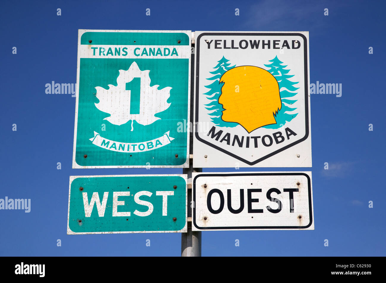 signposts for trans canada highway 1 and yellowhead route in manitoba canada - Stock Image