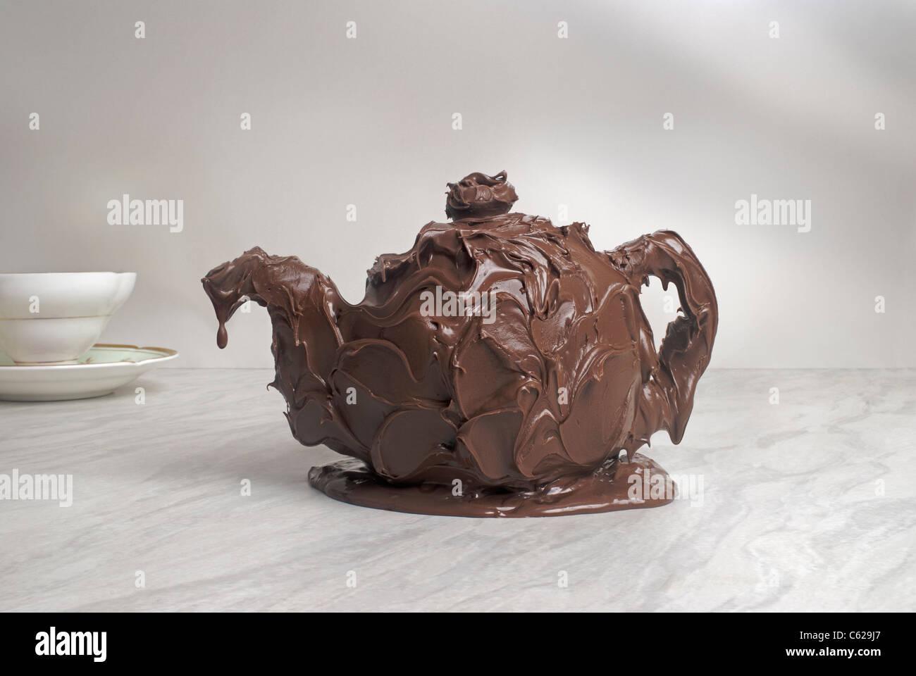 Teapot made of chocolate - Stock Image
