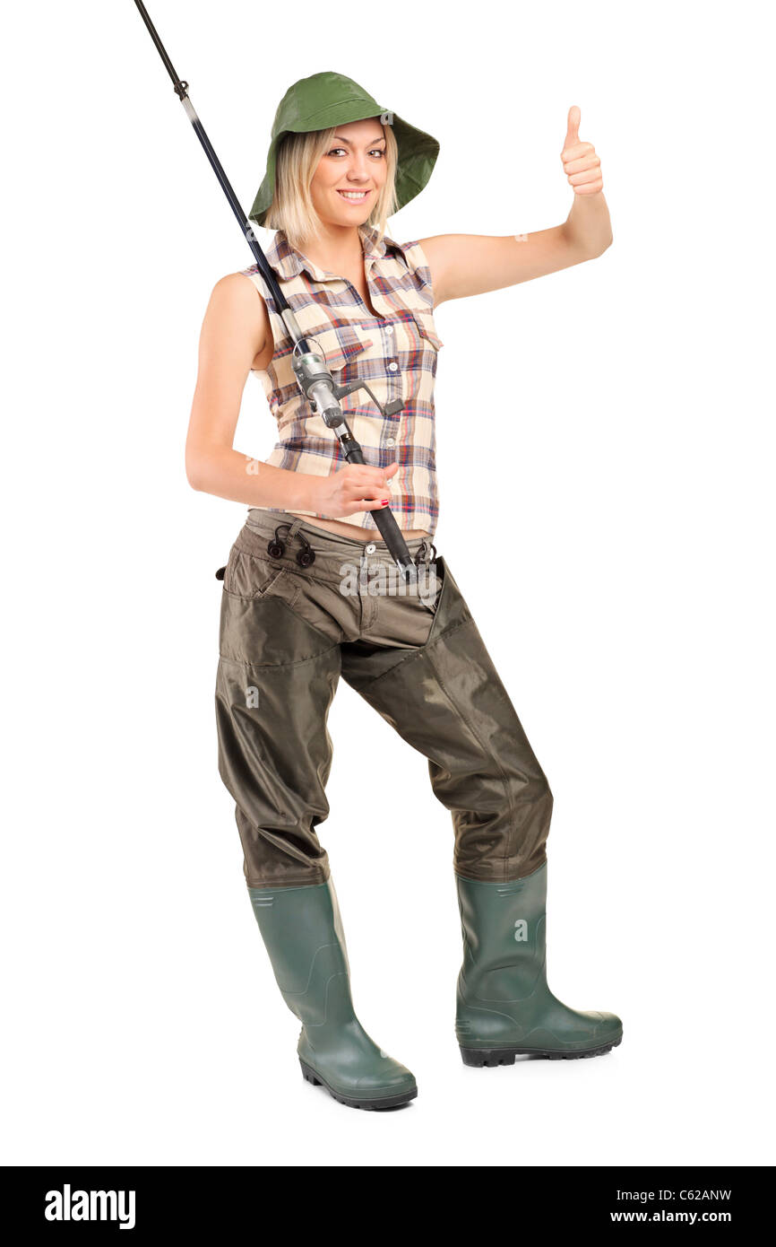 Full length portrait of a smiling fisher woman with thumb up - Stock Image
