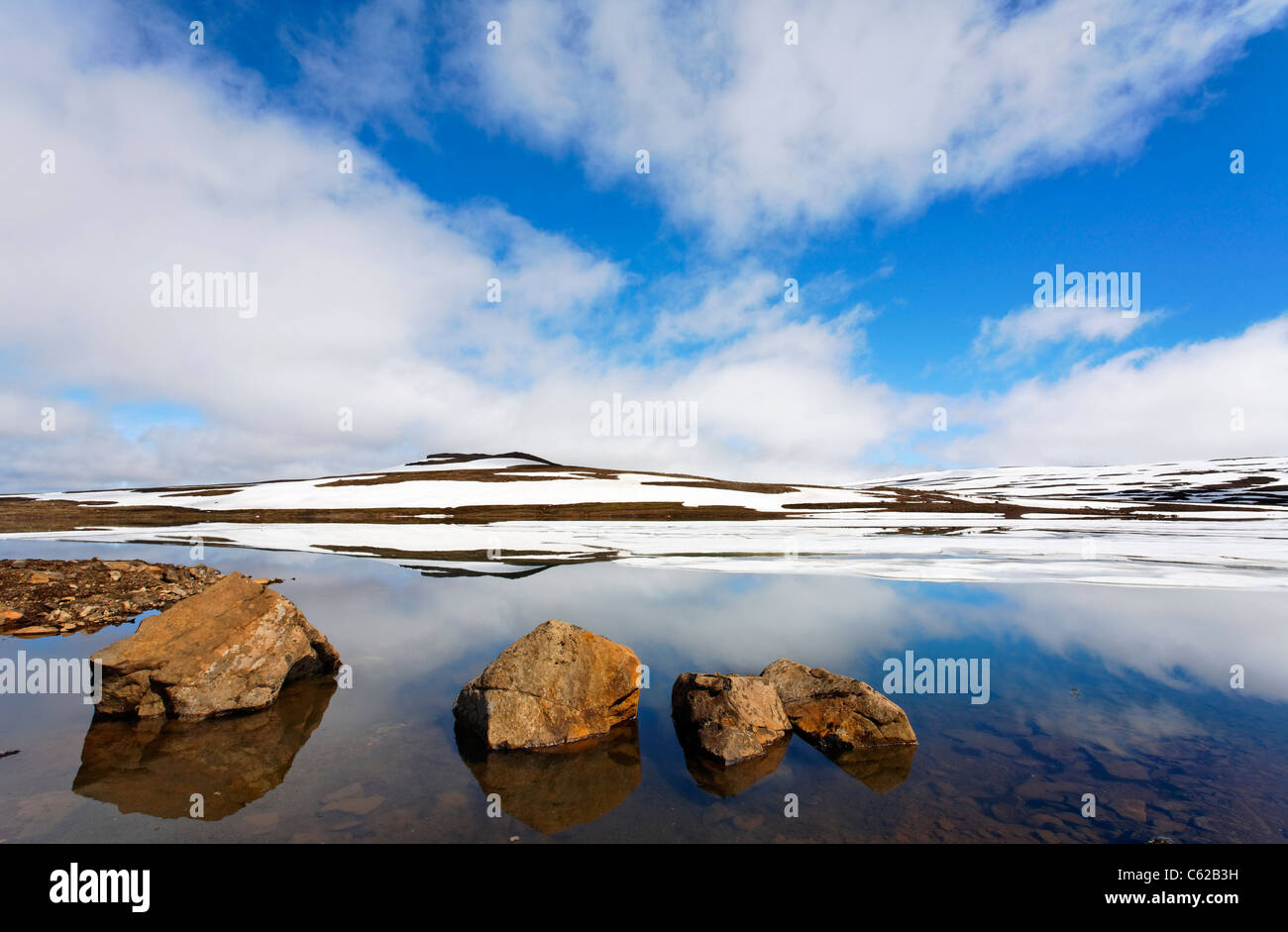 Ice and reflections in a lake, Eastern Fjords, Iceland - Stock Image