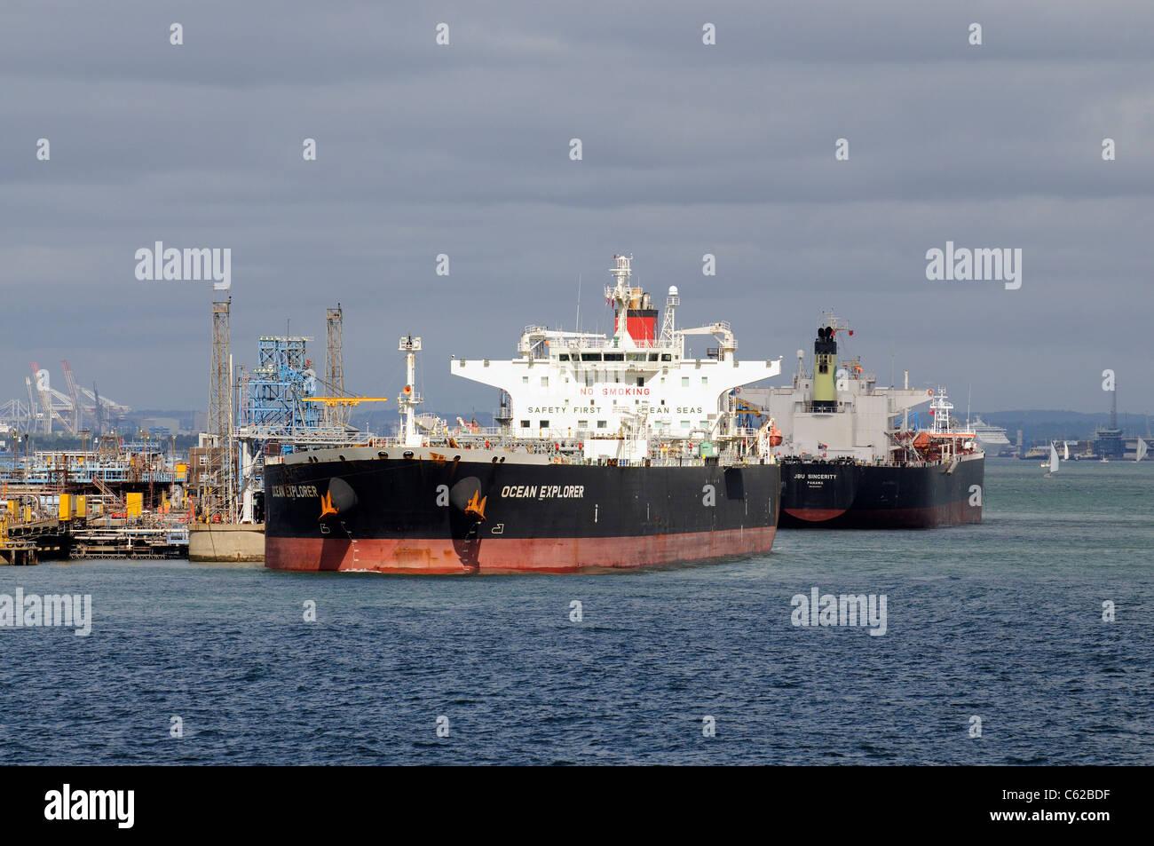 Bulk tanker ship the Ocean Explorer & JBU Sincerity alongside Fawley refinery on Southampton Water southern - Stock Image