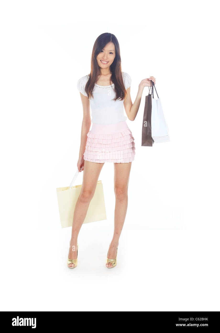 Retail Therapy Concept with Asian Lady and Bags - Stock Image