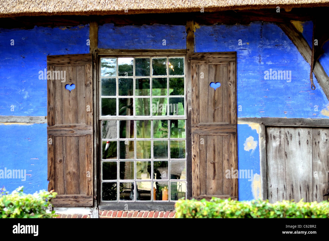 Blue heart windows of a blue house Stock Photo
