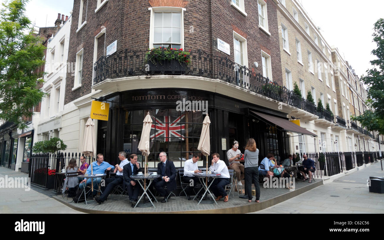London street scene people drinking coffee at coffee shop Tomtom cafe in Victoria at Elizabeth & Ebury Streets Belgravia Stock Photo