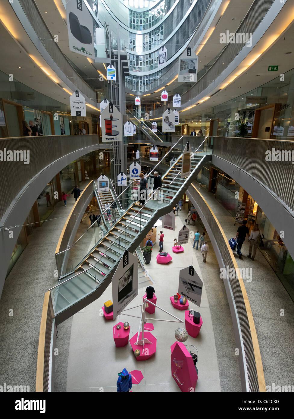 Interior of atrium of modern Stilwerk design shopping mall in Stock ...