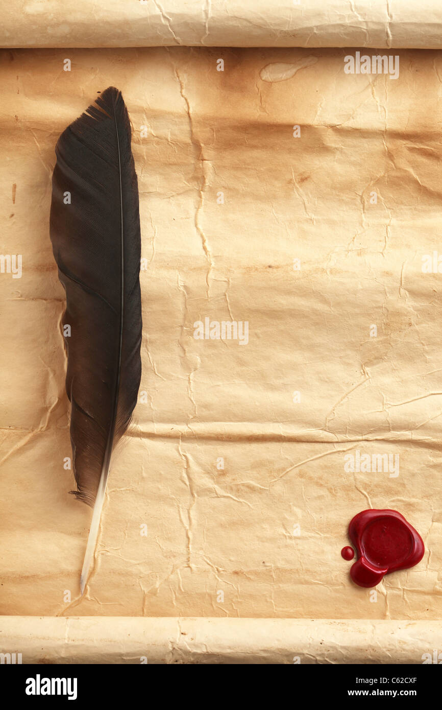 Quill on blank paper with wax seal Stock Photo