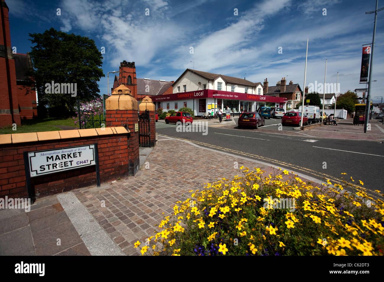 Market Street, Hoylake, Wirral, NW UK showing the corner of St Luke's Methodist Church and the small Sainsbury's - Stock Image