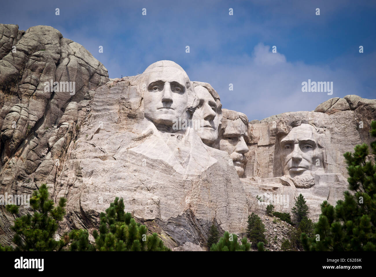 Heads of four American presidents carved in Mount Rushmore in Black Hills South Dakota USA on a sunny summer day Stock Photo