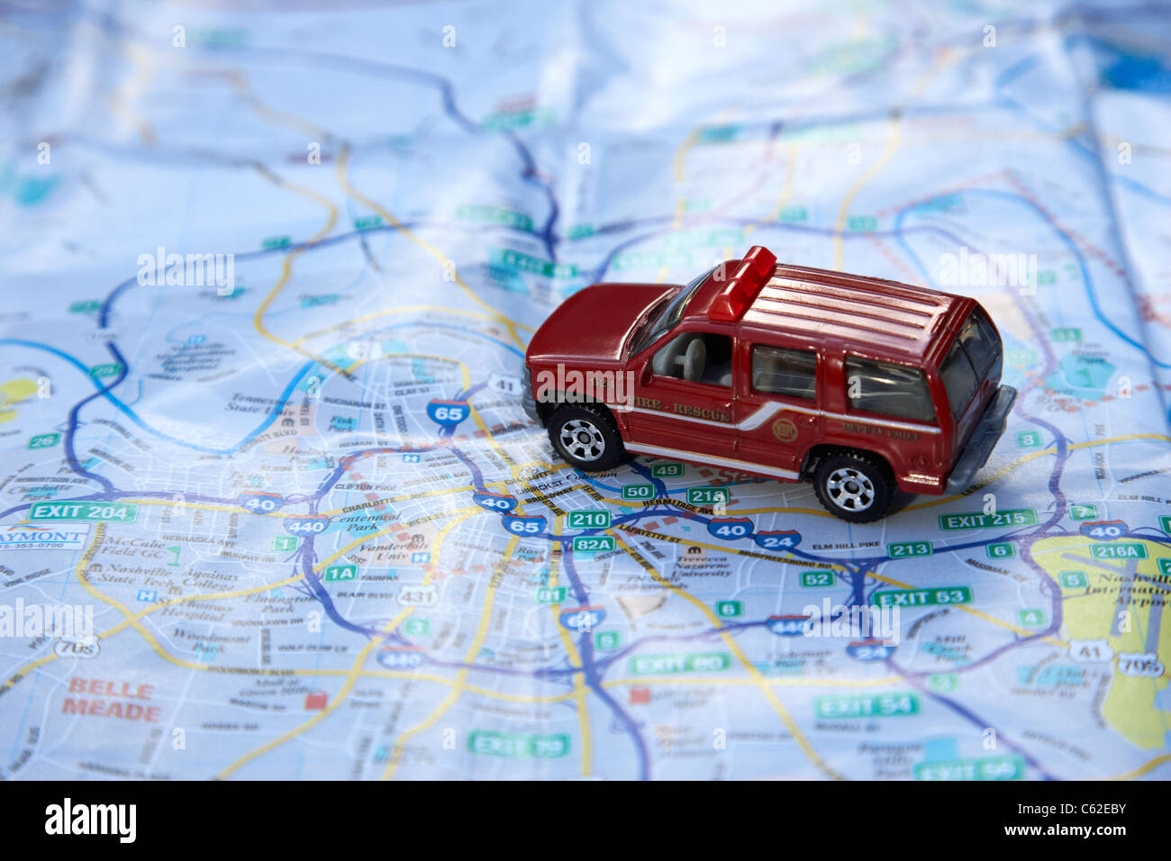 model fire rescue suv on a city map of nashville in the usa - Stock Image