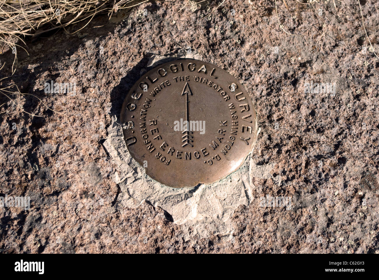 A reference marker found at the peak of Cerro Grande, denoting the location of a US Geological Service survey marker. - Stock Image