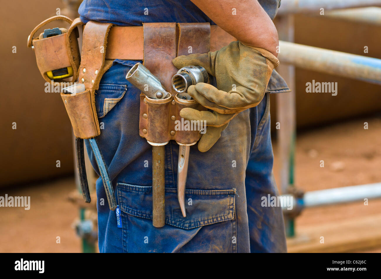 A scaffolder's tool belt - Stock Image