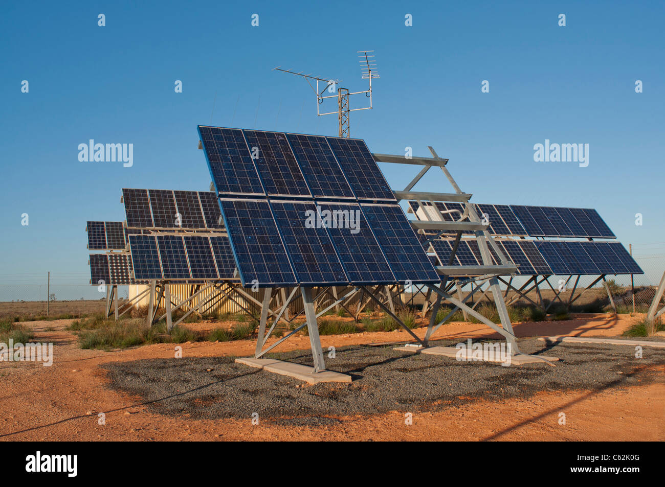 Solar panels used to provide power to telephone relay stations in the Australian outback - Stock Image