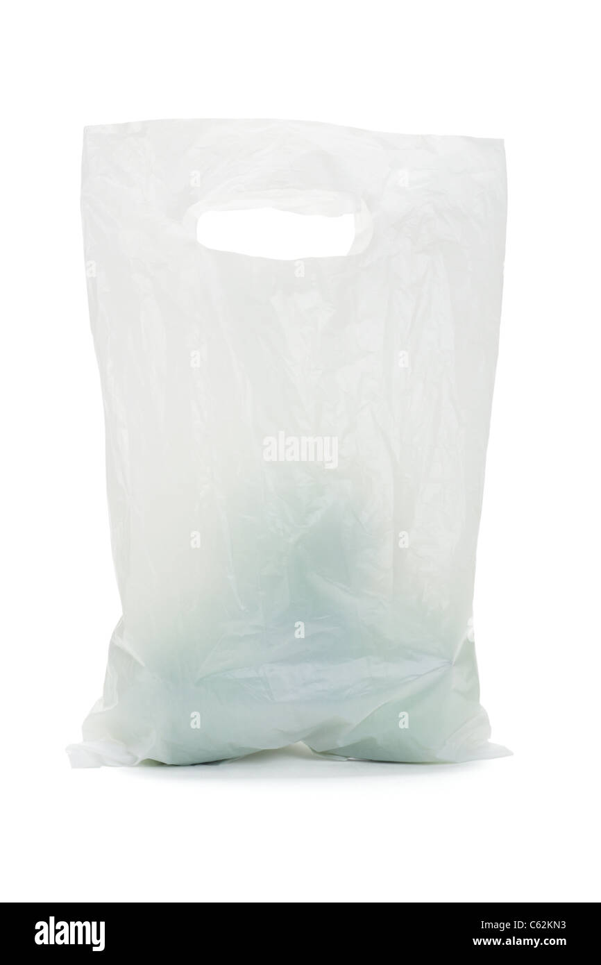 White opaque plastic bag containing green apples on isolated background - Stock Image