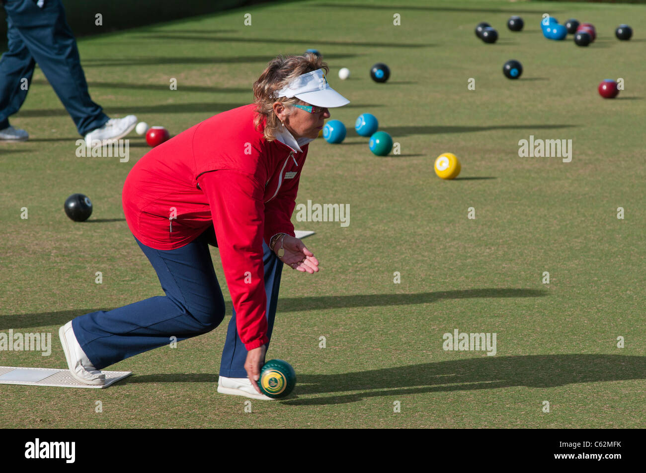 Elderly people playing lawn bowls in South Australia - Stock Image