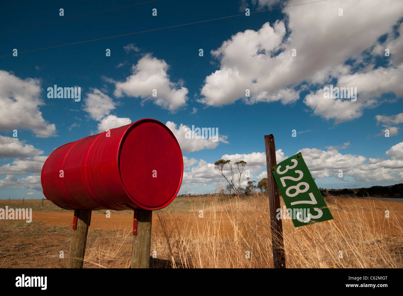 An Australian country mailbox made from a recycled oil drum - Stock Image