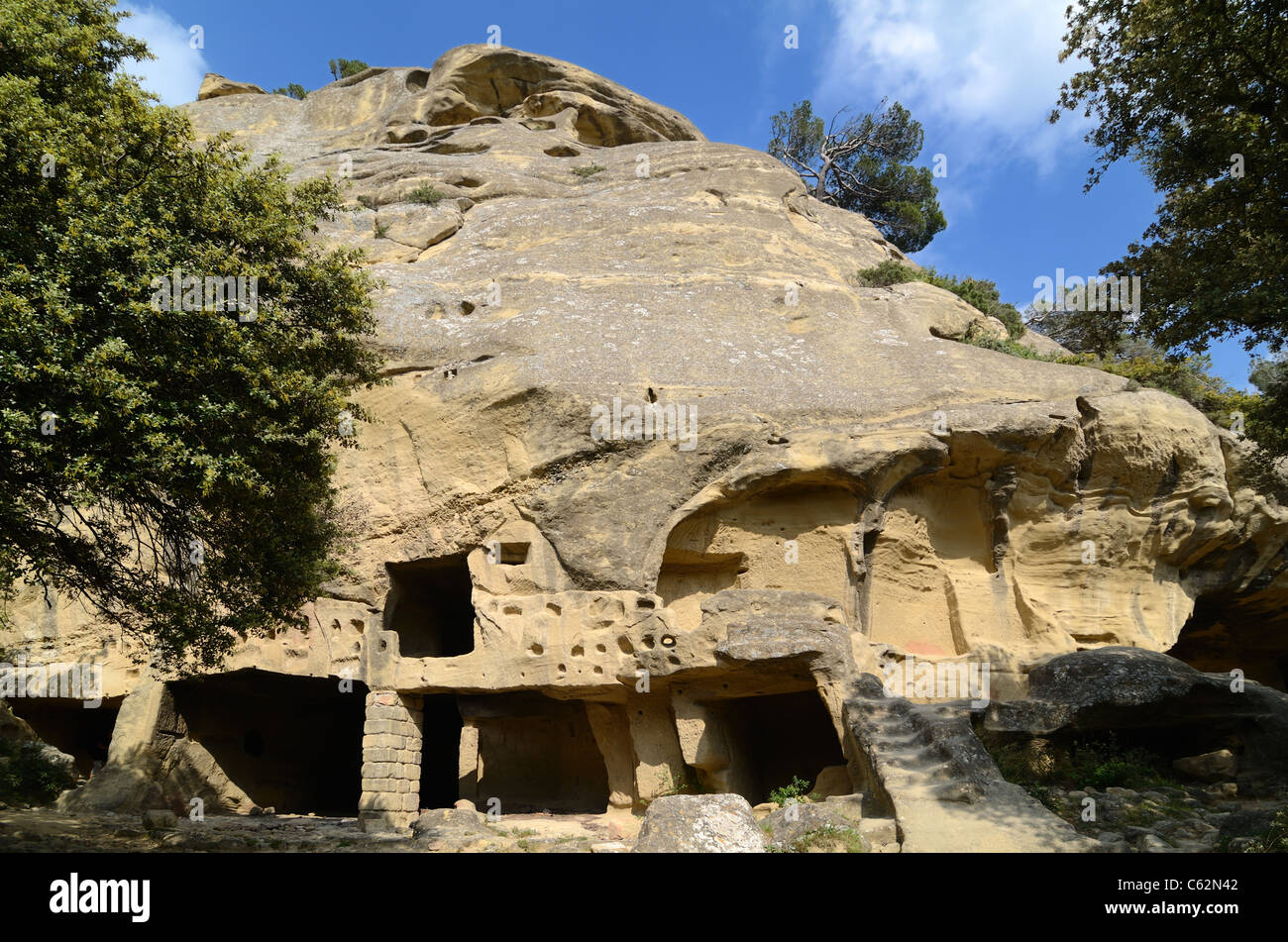 Troglodyte Houses, Cave Houses, or Rock-Cut Dwellings in the Cliff Face at Calès, Lamanon, Provence, France - Stock Image