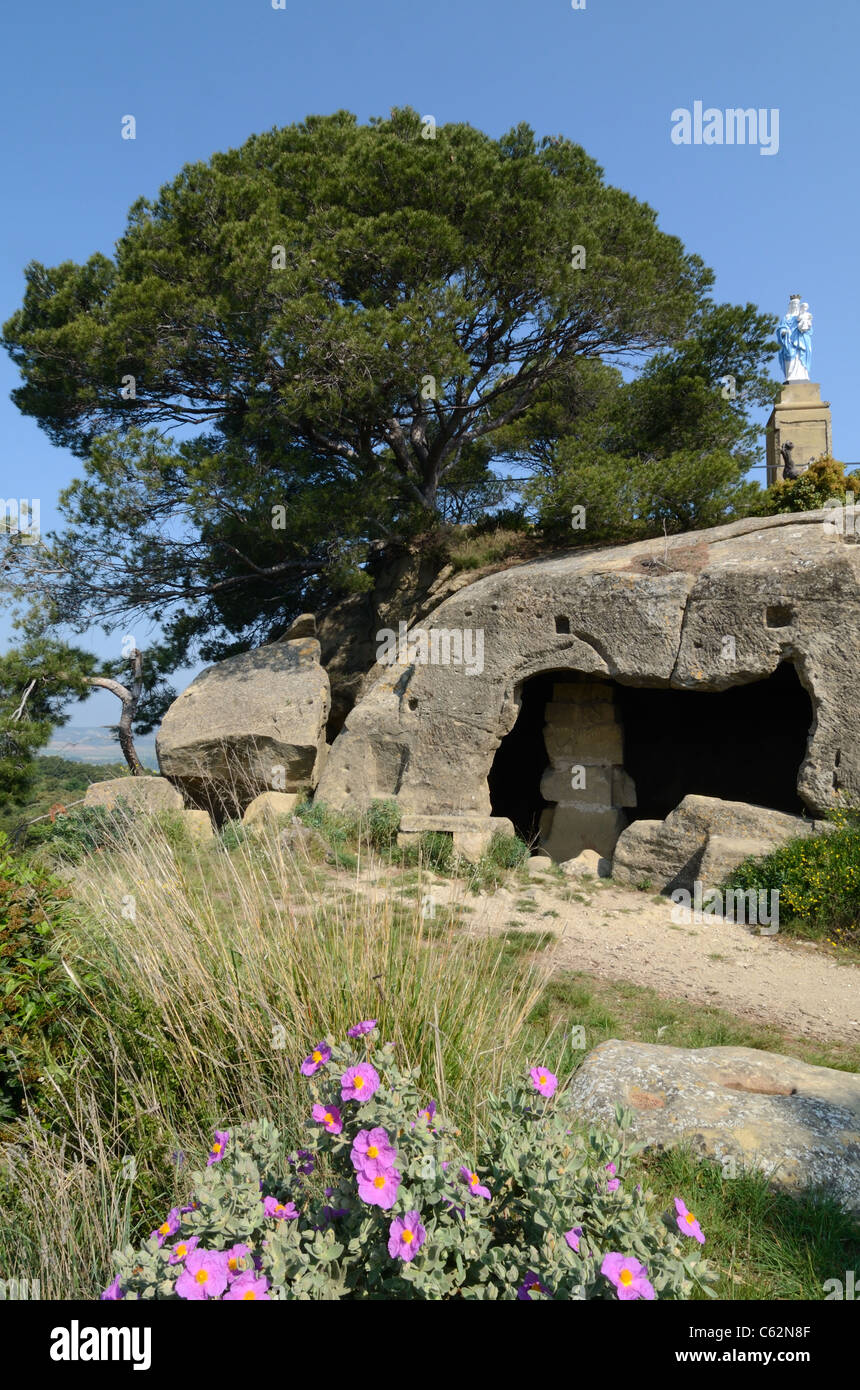 Troglodyte House, Rock-Cut Carved or Cave Dwelling at Calès, Lamanon, Provence, France - Stock Image