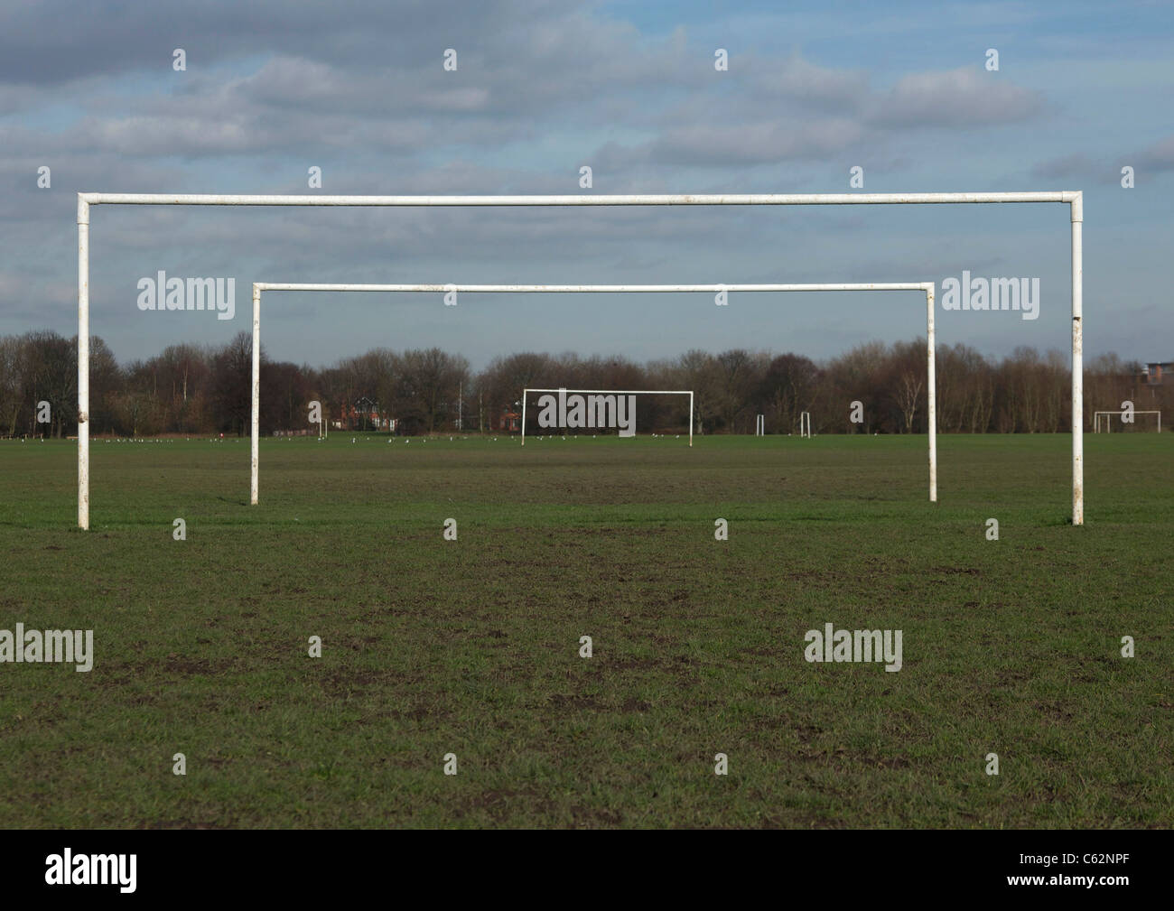 Goal posts within goal posts on adjoining football pitches - Stock Image