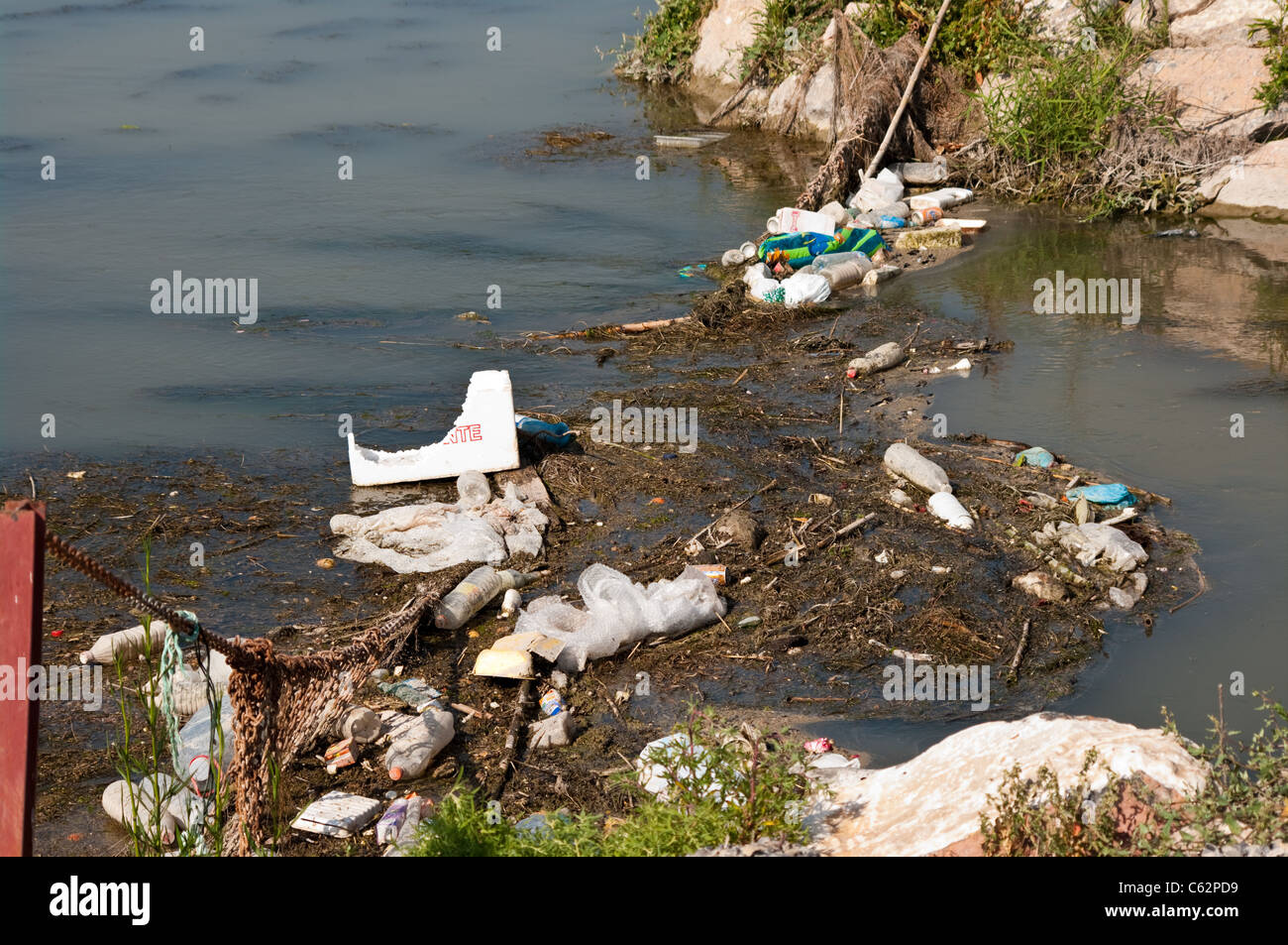 River pollution caused by human waste and discarded rubbish, in a Spanish river - Stock Image