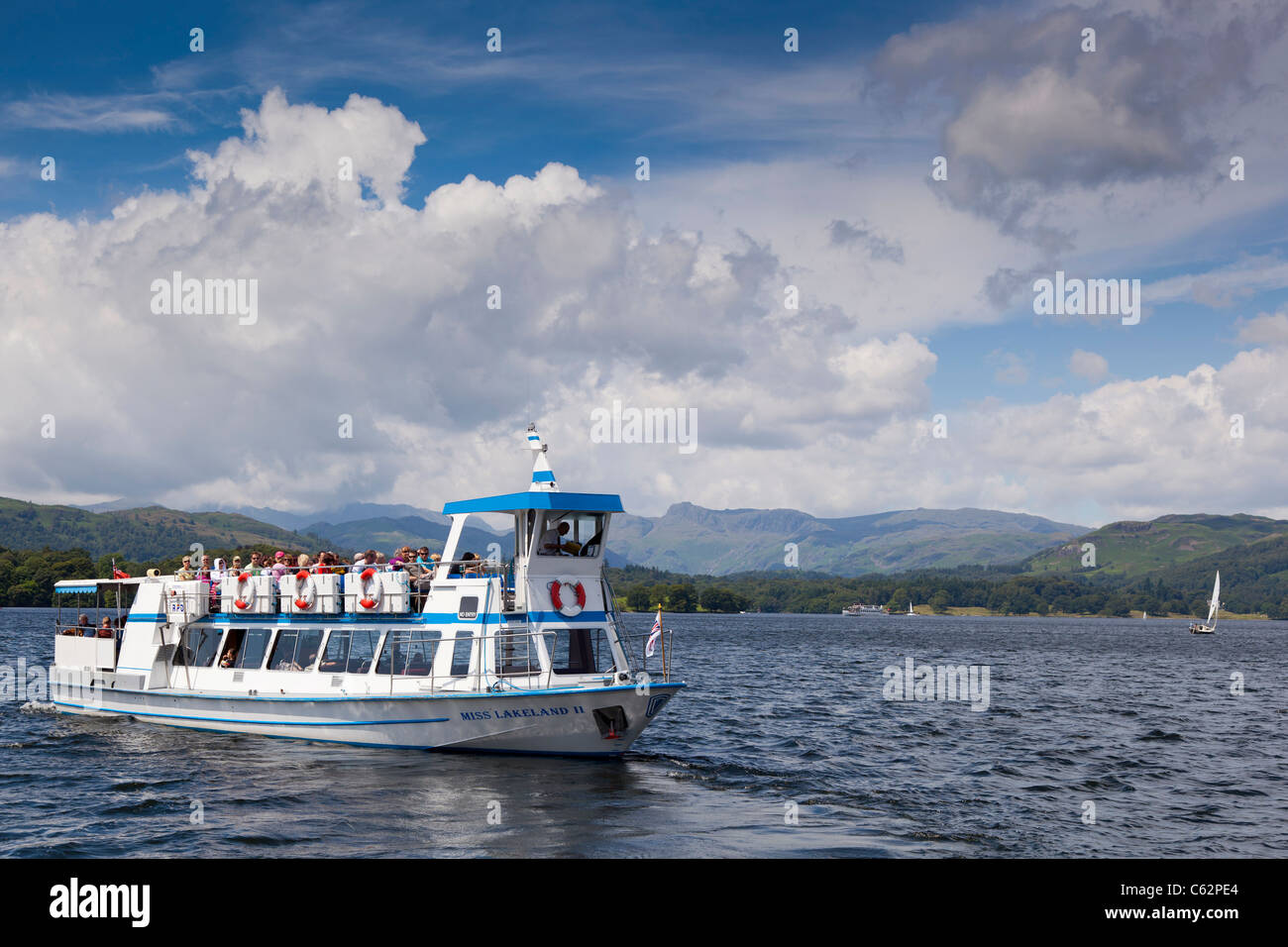 Lake Windermere launch Miss Lakeland 2 leaves the pier at Brockhole Park the Lake District visitor centre. - Stock Image