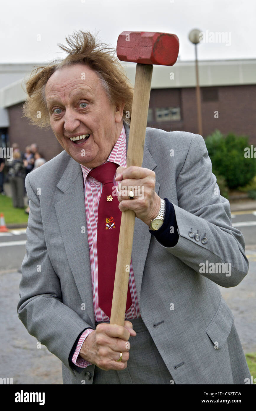 Comedian Ken Dodd with a sledgehammer...pictured at a tree planting ceremony. - Stock Image