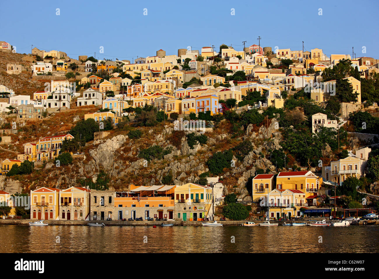 Greece, Symi island, Dodecanese. Partial  view of Gyalos, capital and main port of the island. - Stock Image