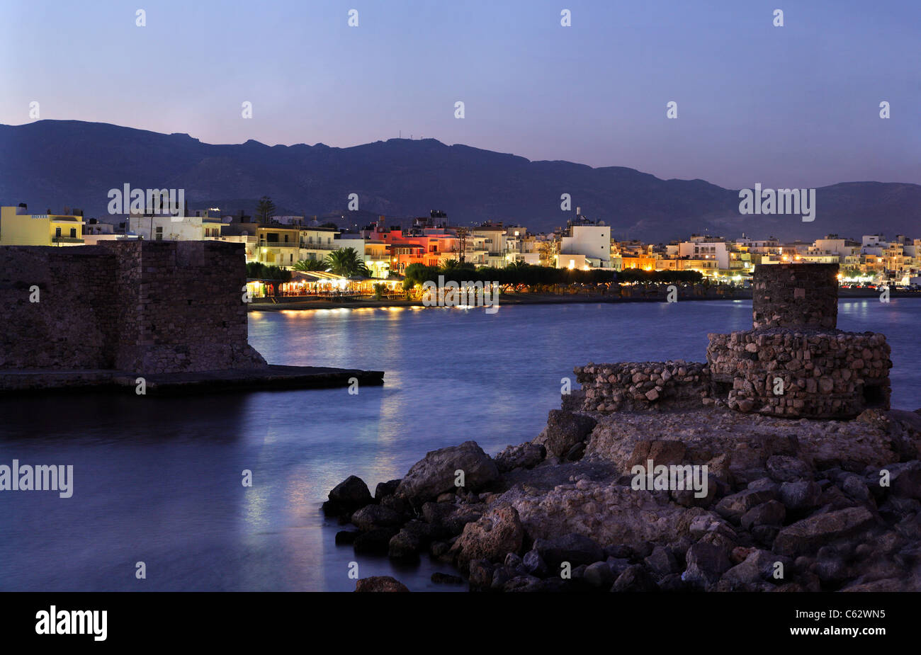 Partial view of Ierapetra, the southernmost town of Europe, 'through' the entrance of the old harbor. Crete - Stock Image