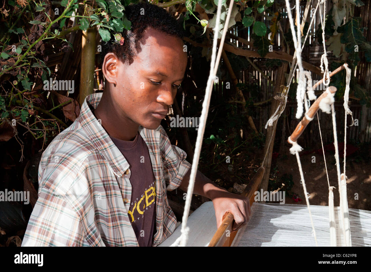 A Dorze tribesman weaving cotton at the village of Chencha near Arba Minch in the Omo Valley, Southern Ethiopia, Stock Photo