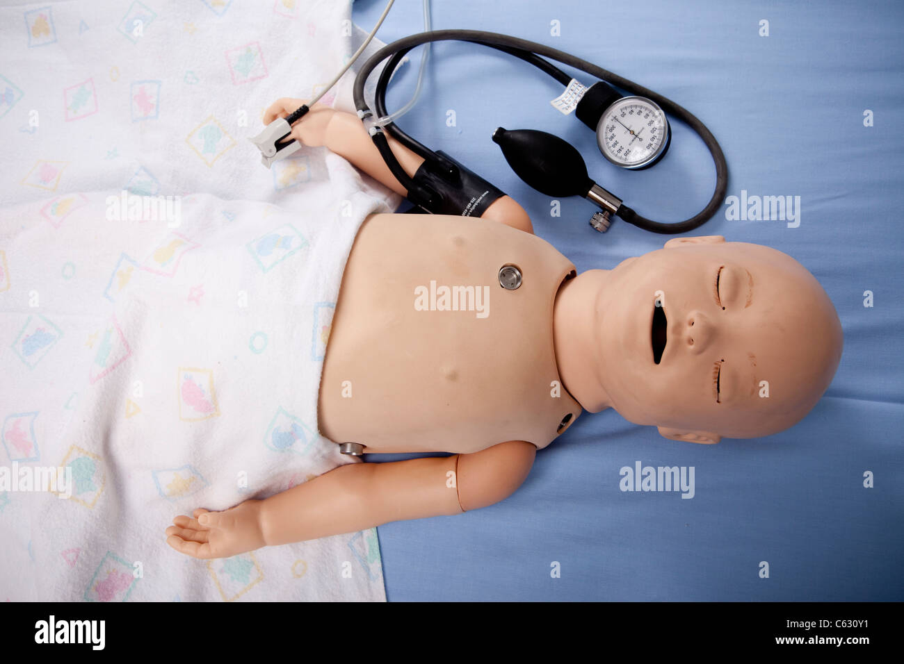 A realistic dummy baby used as a training aid for paediatric nurses. - Stock Image
