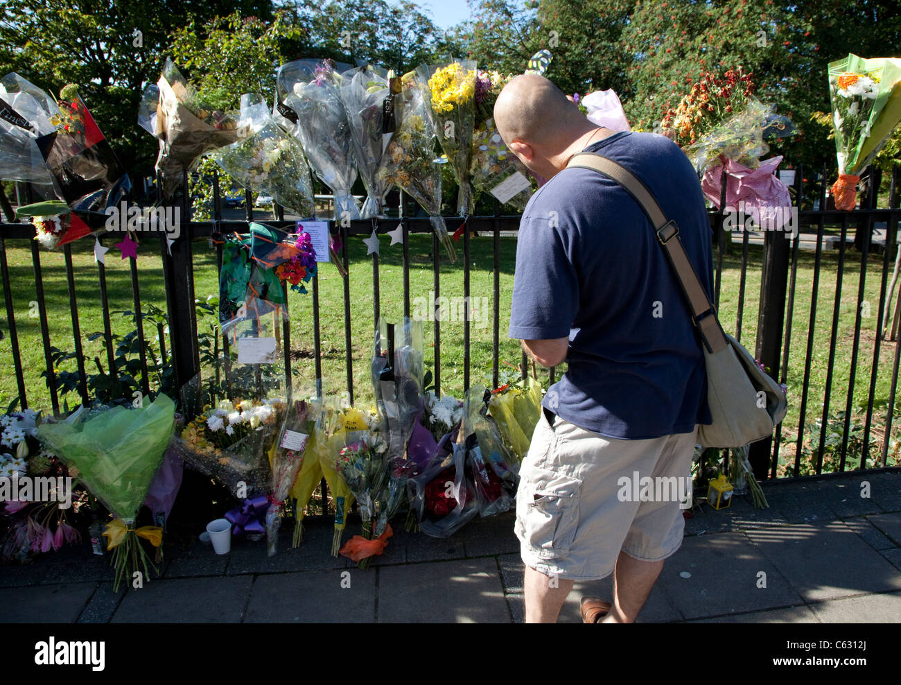 Flowers at spot where Mark Duggan was shot by police in Ferry Lane, Tottenham Hale, London Stock Photo