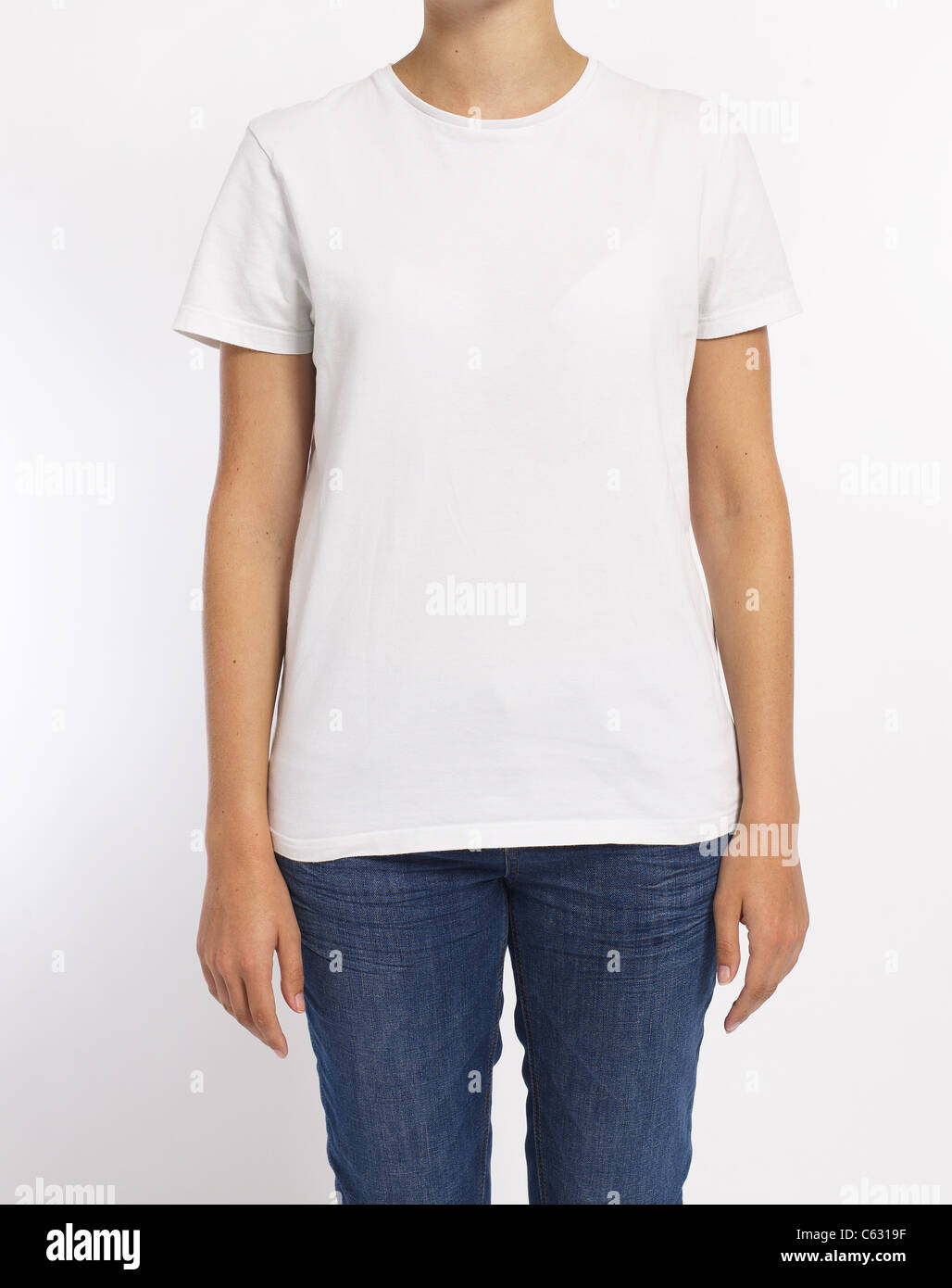 white tee shirt on a model waring jeans face cropped out - Stock Image