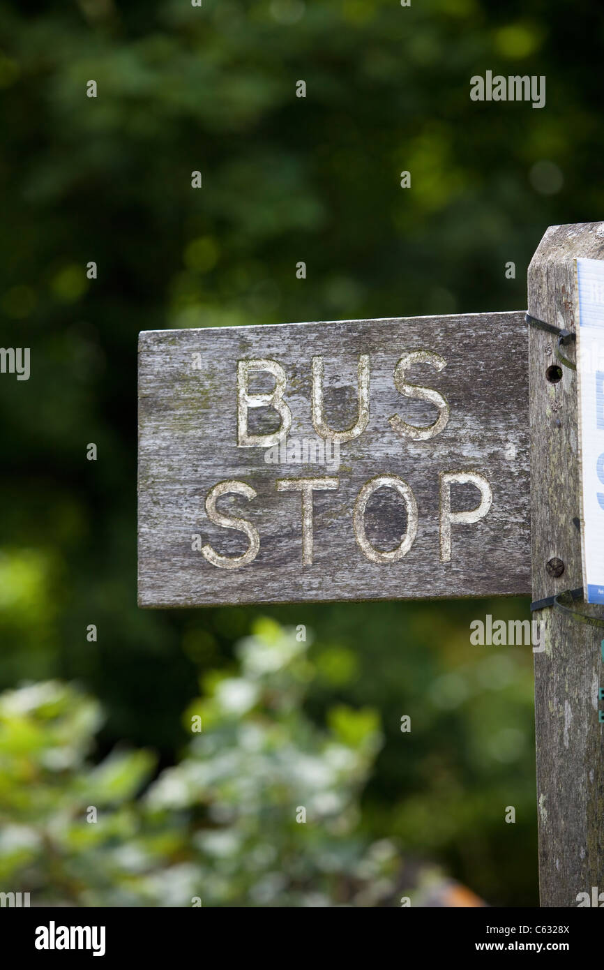 Old Wooden Bus Stop sign with fading white paint - Stock Image
