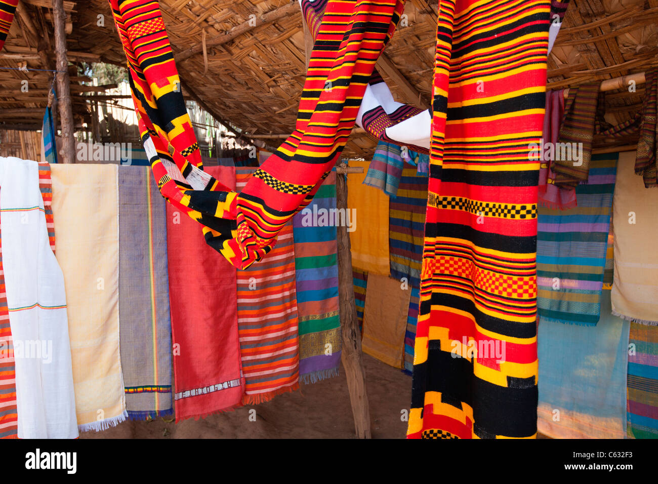 A colourful display of traditional scarves/ shammas woven at the village of Chencha nr.  Arba Minch in the Omo Valley, Stock Photo